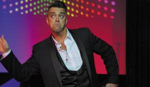 Paul Reason as Robbie Williams