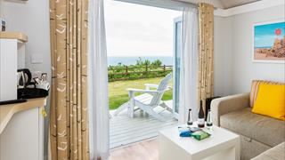 Carousel Item 4: Corton Clifftop Lodge with sea view
