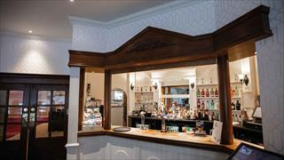 Carousel Item 4: Get a drink at the hotel bar at Cricket St. Thomas.
