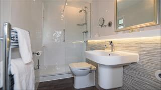 Carousel Item 5: White and chrome bathroom of a Premier chalet